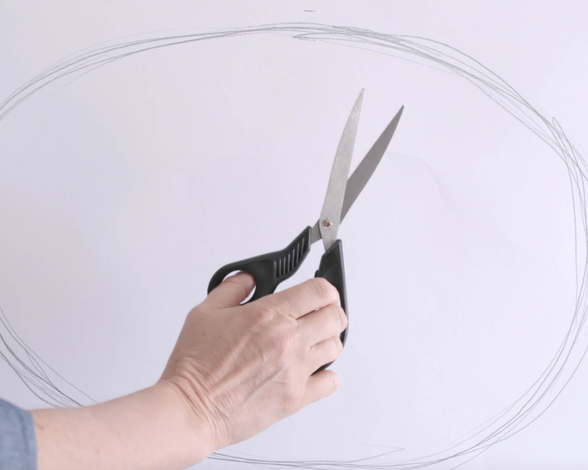Draw your oval shape on paper and cut it out