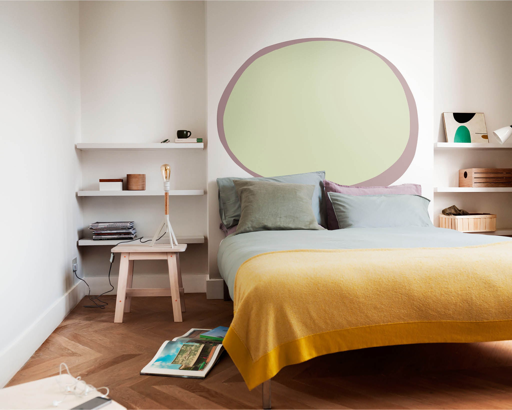 Bedroom with a painted oval on the wall