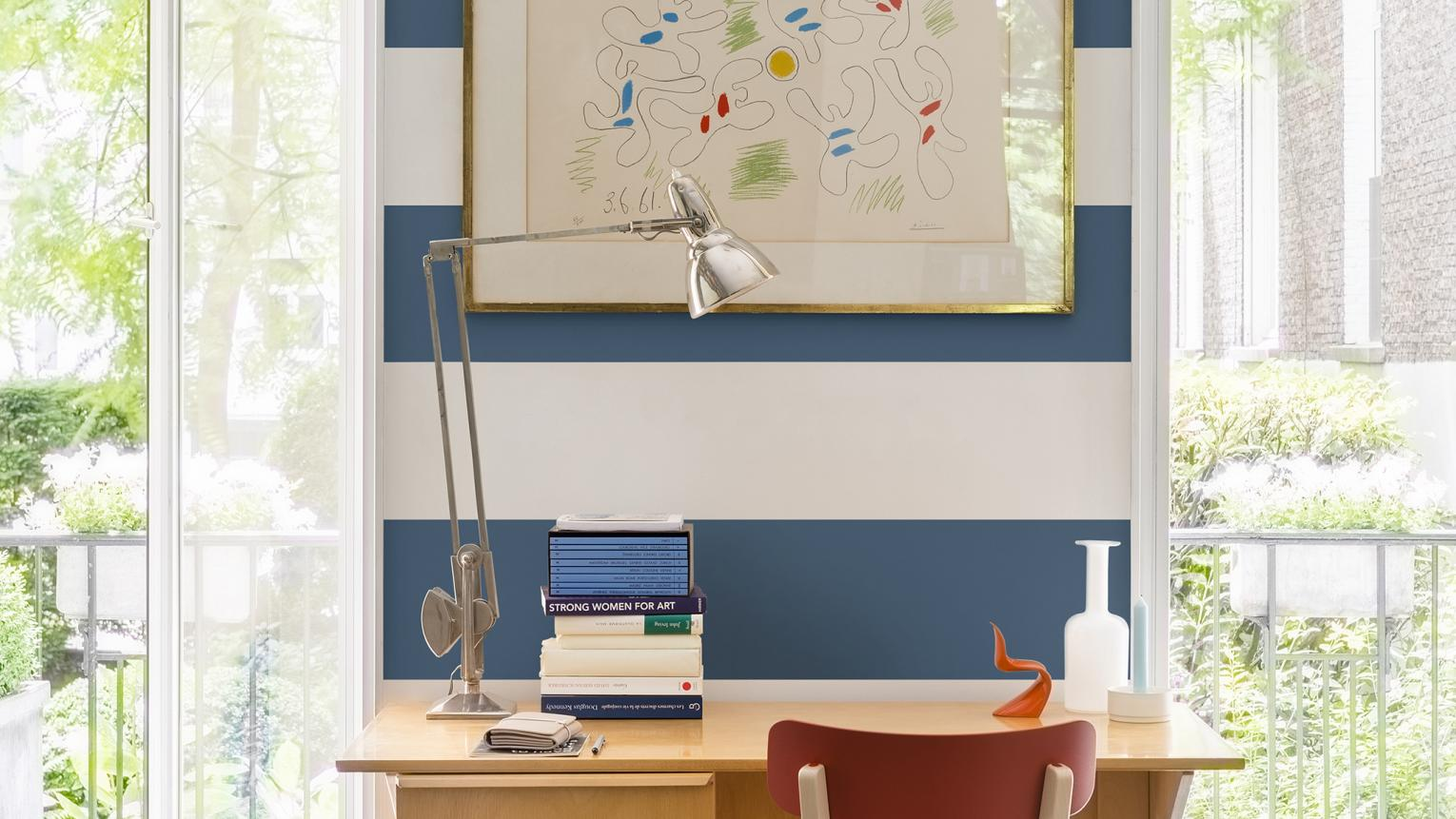 Learn how to create a nautical-themed study area by painting a feature wall of bold blue and white stripes.