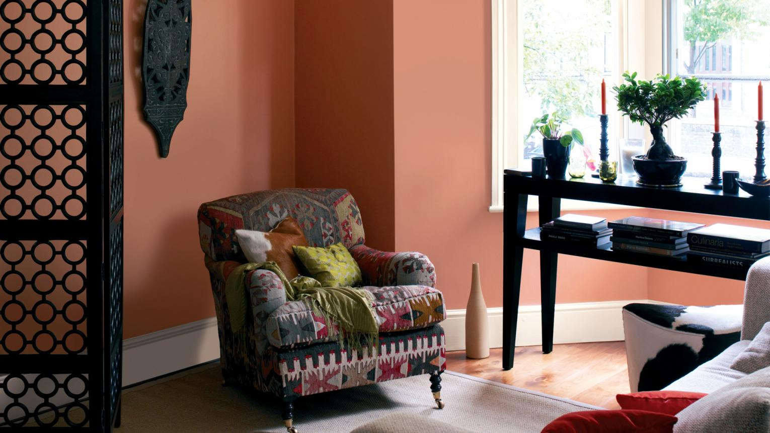 Paint your walls warm terracotta to create a welcoming glow.
