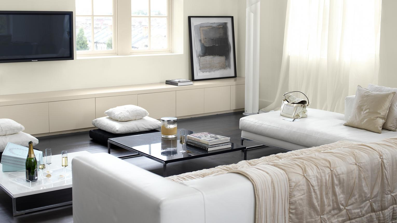 Soften a sleek, contemporary living room with gentle off-whites.