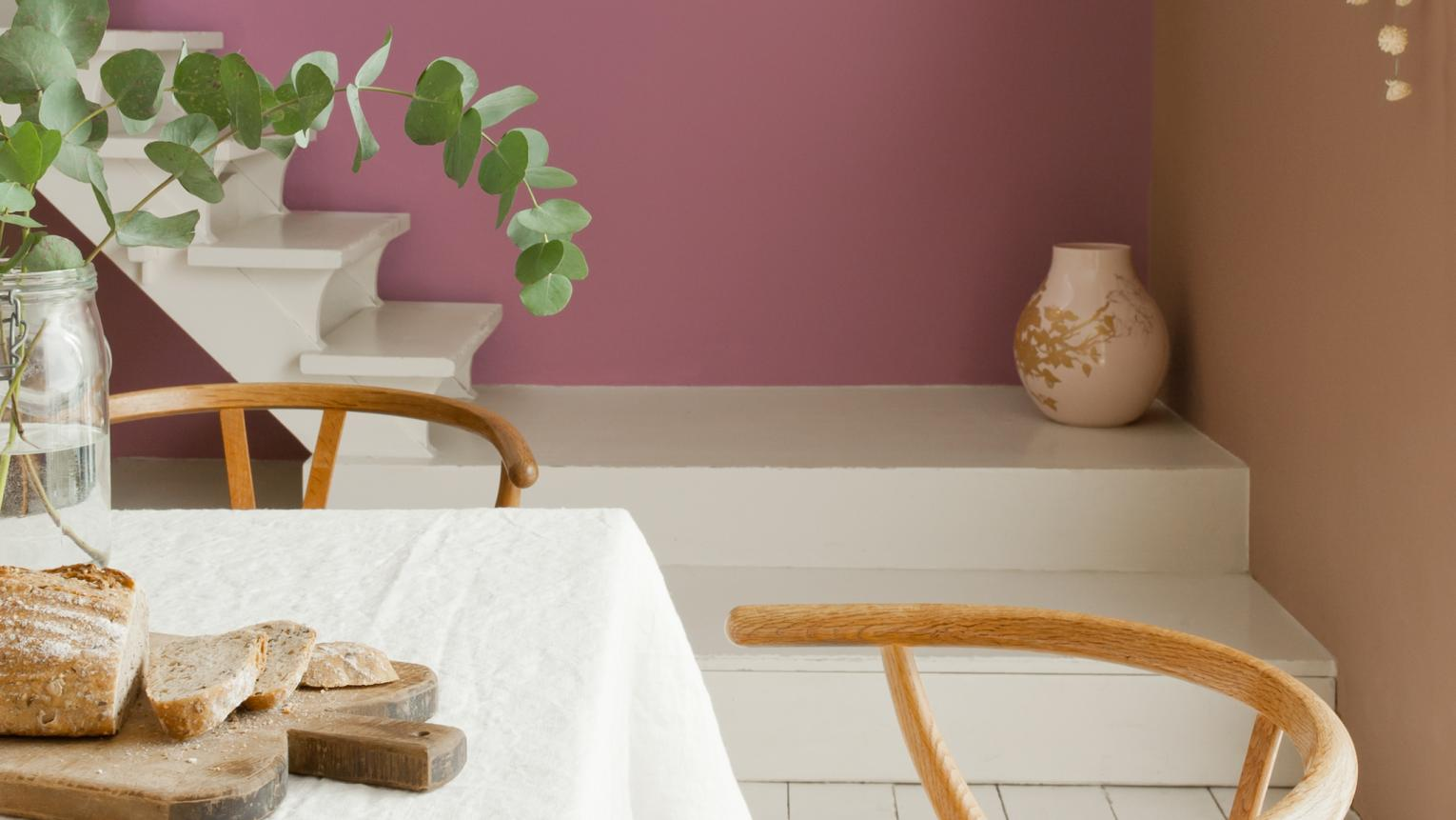 Warm shades of berry purple and brown inspire intimate dining.