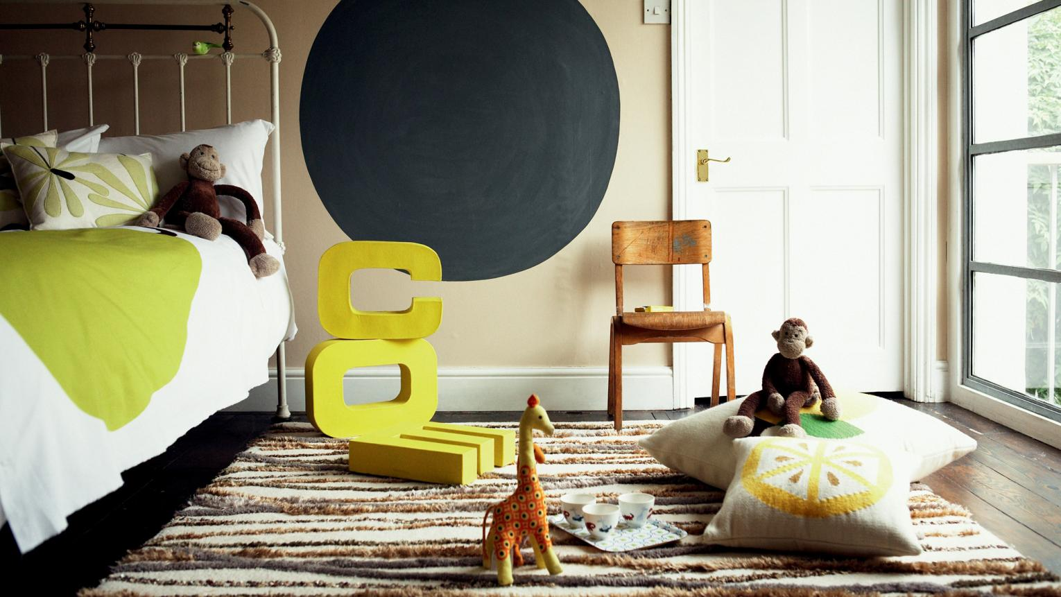 Create a calm children's room with warm neutrals and bright touches.