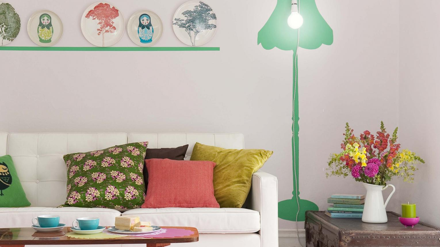 Create the illusion of space in a small living room with bright colours and surprising accent hues.
