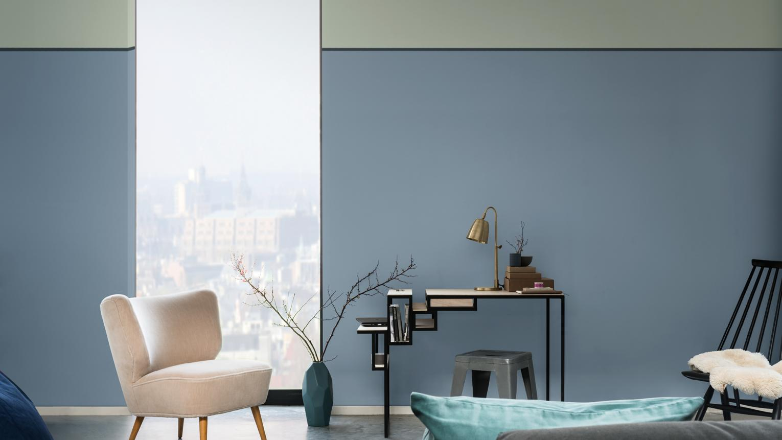 Create a calm working environment with a two-tone wall in a blue palette.