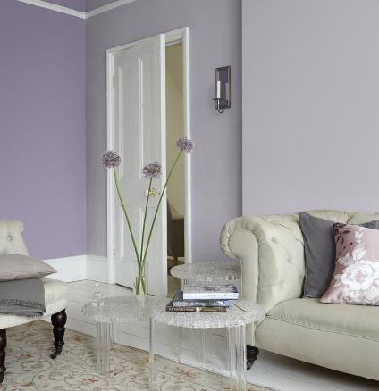 For an elegant living room that radiates romance, paint lilac and lavender walls with traditional white trim and add classic accessories.