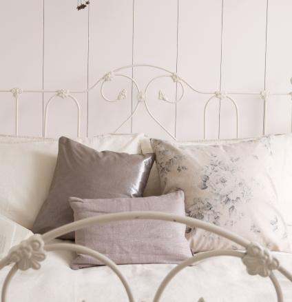 Layer shades of white in the bedroom to create a haven of calm.