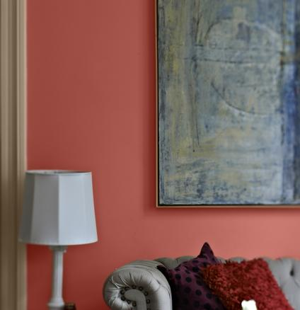 For a passionate living room, why not try painting your space in bold red. This stylish living space takes its inspiration from Spanish-style interiors.