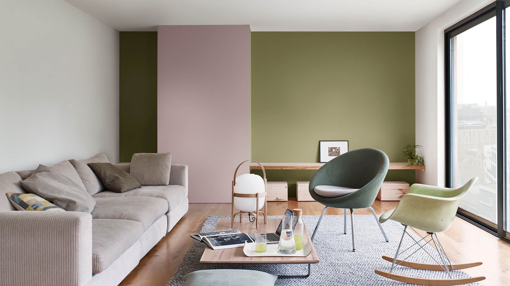 A living room painted in natural pinks and greens